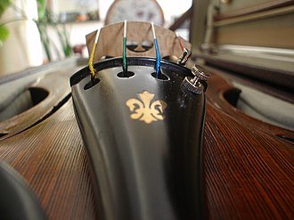 Violin - Closeup of a violin tailpiece, with a fleur-de-lis