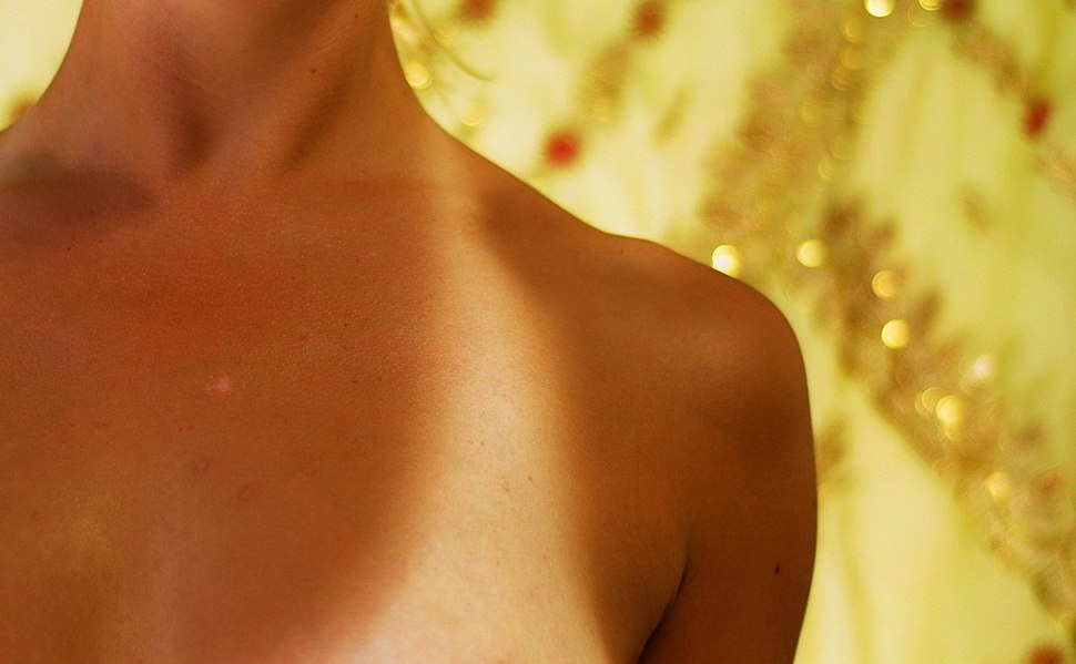 Tan lines on human female chest