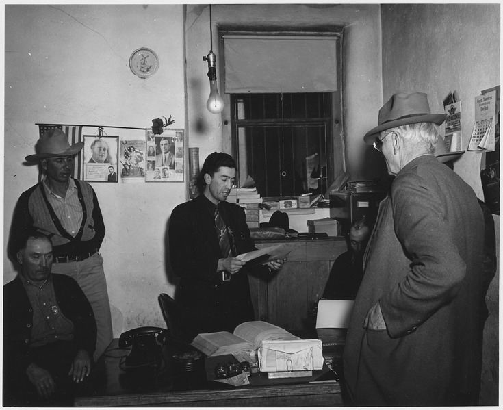 File:Taos County, New Mexico. Sheriff Montoya discusses business with a process server. - NARA - 521883.tif