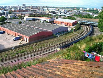 Totterdown, Bristol - Temple Meads rail station approaches from Richmond Street, edge of Totterdown, with the Bath Road bridge over the rail lines to the right of image, the Fowlers motorcycle store ('L' shaped building) and modern industrial units in foreground