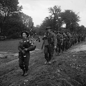 Argyll and Sutherland Highlanders - The 2nd Battalion, led by their piper, advance during Operation Epsom in Normandy in June 1944
