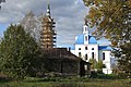 The Church of Archangel Michael in Village Podzhigorodovo (1778-1783). View from the south over an old village house..jpg
