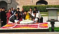 The King of Bhutan, His Majesty Jigme Khesar Namgyel Wangchuck and the Bhutan Queen, Her Majesty Jetsun Pema Wangchuck laying wreath at the Samadhi of Mahatma Gandhi, at Rajghat.jpg
