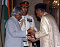 The President, Dr. A.P.J. Abdul Kalam presenting Padma Bhushan to a renowned musician, Ustad Sabri Khan, at investiture ceremony in New Delhi on March 29, 2006.jpg