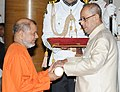 The President, Shri Pranab Mukherjee presenting the Padma Bhushan Award to Swami Tejomayananda, at a Civil Investiture Ceremony, at Rashtrapati Bhavan, in New Delhi on April 12, 2016.jpg