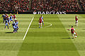 Theo Walcott takes a free kick (7100478075).jpg
