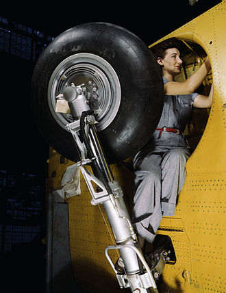 Vultee A-31 Vengeance - Worker at Vultee-Nashville makes final adjustments in the wheel well of an inner wing before the installation of the landing gear. (February 1942)