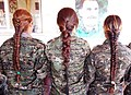 Three YPJ soldiers with braided hair.jpg