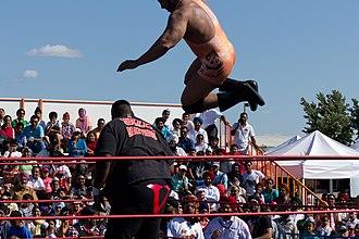 Tiger Ali Singh - Tiger Ali Singh (in orange) performing the Tiger Bomb against Viscera