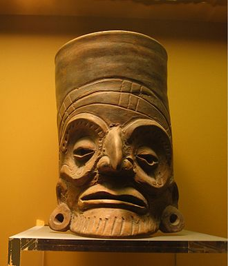 Toltec - An expressive orange-ware clay vessel in the Toltec style, from the American Museum of Natural History collection.