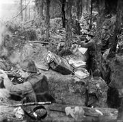 Troops from the 1st Battalion, South Lancashire Regiment man trenches in the front line in Holland, 25 November 1944. B12134