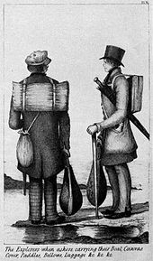 Two men carrying wooden sticks. One wears a small knapsack and the other carries a large furled umbrella.