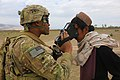 U.S. Army Spc. Jordon Purgat, left, assigned to the 1st Battalion, 187th Infantry Regiment, uses a device to conduct retinal scan identification on an Afghan villager during Operation Shamshir VI in Khoti Kheyl 130507-A-NQ567-044.jpg