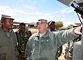 U.S. Army Staff Sgt. Mark Haberland, center, a water purification supervisor with Alpha Company, 405th Brigade Support Battalion, Illinois Army National Guard, explains the tactical water purification system to 120808-Z-VI159-046.jpg