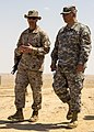 U.S. Marine Corps Lt. Col. Kevin Collins, left, the commanding officer of Combat Logistics Battalion 26, 26th Marine Expeditionary Unit, and Army Maj. Gen. Robert Catalanotti discuss training for Eagle Resolve 130429-M-HF949-004.jpg
