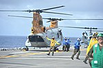 U.S. Navy Aviation Boatswain's Mate Handling Airman Omar Vega directs a Marine Corps CH-46 Sea Knight helicopter assigned to Marine Medium Squadron (HMM) 262 in for a safe landing aboard amphibious assault ship 120822-N-BL607-007.jpg