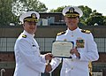 U.S. Navy Cmdr. Todd Weeks, right, receives a Meritorious Service Medal for his successful tour as commanding officer of the attack submarine USS Alexandria (SSN 757) during a change of command ceremony Aug. 1 130801-N-TN558-095.jpg
