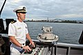 U.S. Navy Lt. j.g. Benjamin Bond adjusts the throttle aboard the patrol coastal ship USS Hurricane (PC 3) as the ship arrives in Milwaukee, Wis., Aug. 9, 2012, as part of Milwaukee Navy Week 120809-N-YZ751-012.jpg