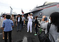 U.S. Navy Rear Adm. Michael S. White, the commander of Carrier Strike Group (CSG) 11, gives a tour of the flight deck to Thai military members and nationals aboard the aircraft carrier USS Nimitz (CVN 68) 130529-N-BJ752-035.jpg