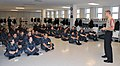 U.S. Navy recruits with the Recruit Training Command at Naval Station Great Lakes in Illinois listen to a presentation by Petty Officer 2nd Class Chris Shaw, right, their recruit division commander, Sept 110908-N-IK959-576.jpg
