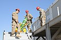 U.S. Soldiers with the 760th Engineer Company, 489th Engineer Battalion, attached to the U.S. Central Command Materiel Recovery Element of the 82nd Sustainment Brigade, prepare to remove a staircase from 131111-A-MU632-751.jpg
