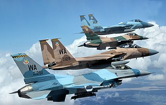United States Air Force Warfare Center - A flight of Aggressor F-15 Eagles and F-16 Fighting Falcons fly in formation over the Nevada Test and Training Range