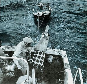 United States Coast Guard Auxiliary - Auxiliarists in 1967 rescuing a boater off an outboard that had foundered during a storm in Long Island Sound, New York.