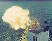 USCG Cook Inlet conducts fire support off the coast of Vietnam in 1971.
