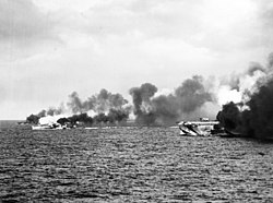USS Gambier Bay (CVE-73) and escorts making smoke off Samar 1944