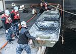 USS George Washington sailors collect debris 150119-N-DE001-005.jpg