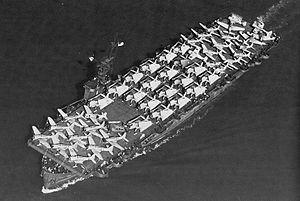 USS Liscome Bay c самолётами SBD Dauntless,TBF Avenger и F4F Wildcat на полётной палубе(фото датировано 20 сентября 1943 года) [1]