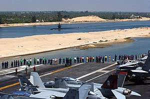 USS Philadelphia (SSN-690) - Sailors aboard the Nimitz-class aircraft carrier USS ''Carl Vinson'' observe the USS Philadelphia as the ships pass one another in the Suez Canal (2005).