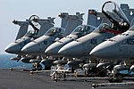 US Navy 030315-N-9593M-008 Five F-A-18C Hornets assigned to Strike Fighter Squadron Twenty Five (VFA 25) and armed with AIM-7 'Sparrow' air-to-air missiles.jpg
