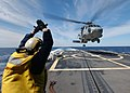 US Navy 040309-N-4374S-018 A landing signal enlisted (LSE) assigned to the guided missile frigate USS Taylor (FFG 50) signals an HH-60H Seahawk assigned to the Red Lions of Helicopter Anti-Submarine Squadron One Five (HS-15) fo.jpg