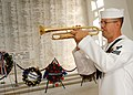 US Navy 041207-N-9662L-121 Musician 1st Class Guy Gregg plays Echo Taps from the shrine room aboard the USS Arizona Memorial during the 63rd commemorative anniversary of the Dec. 7, 1941 attack on Pearl Harbor, Hawaii.jpg