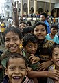 US Navy 050106-N-6817C-442 Indonesian children smile and cheer as U.S. Navy helicopters from USS Abraham Lincoln (CVN 72) fly-in purified water and relief supplies to a small village on the Island of Sumatra, Indonesia.jpg