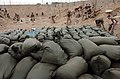 US Navy 050218-N-6967M-819 U.S. Marines and Sailors assigned to 1st Marine Division, 2nd Battalion, 5th Marines, fill sand bags to make new checkpoints and reinforce old ones throughout Ramadi, Iraq.jpg