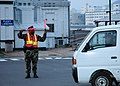 US Navy 050225-N-2970T-007 Master-at-Arms 2nd Class Rajohn R. Revies directs traffic at a busy intersection in front of Fleet Landing on board U.S. Fleet Activities Sasebo, Japan.jpg