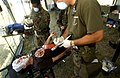 US Navy 050919-F-5789F-163 U.S. Navy medical technicians assess an injured civilian during a simulated man-made disaster.jpg