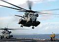US Navy 060219-N-0237L-043 Aboard the amphibious assault ship USS Essex (LHD 2), two CH-53E Super Stallions belonging to Marine Air Combat Element (HM) 262 depart the flight deck.jpg