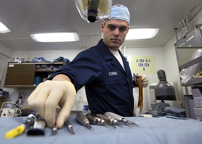 US Navy 060516-N-1745W-039 Hospital Corpsman Steffon Corna sets up dental tools for a tooth extraction in the Dental Department aboard the Nimitz-class aircraft carrier USS Abraham Lincoln (CVN 72)