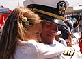 US Navy 070503-N-3901L-094 Lt. Cmdr. Todd Echols embraces his daughter during a homeport arrival ceremony for crew members assigned to USS New Orleans (LPD 18).jpg