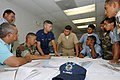US Navy 070530-N-0989H-003 Storekeeper 2nd Class Alfonso Anglada, Task Group 40.9 interpreter, explains symbols used on a chart to Honduran navy, Marine force, and port authority personnel during navigation subject matter excha.jpg