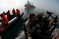 US Navy 070603-N-0684R-310 Visit, board, search and seizure (VBSS) team members, assigned to guided-missile destroyer USS Preble (DDG 88), and Iraqi forces wait for authorization before boarding an oil rig.jpg