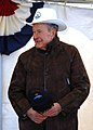 US Navy 080125-N-2510R-004 Former President George H. W. Bush wears the cowboy-style hard hat presented to him by Capt. Kevin O'Flaherty, commanding officer of the Precommissioning Unit (PCU) George H.W. Bush (CVN 77), during a.jpg
