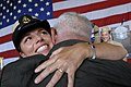 US Navy 080825-N-9818V-272 Chief Aviation Warfare Systems Operator Kathleen Reilly hugs her father.jpg
