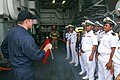 US Navy 081014-N-2013O-006 Damage Controlman 1st Class Robert Lyons explains the purpose of flags used during damage control drills to sailors of the Royal Cambodian navy.jpg