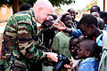 US Navy 090207-N-3875H-051 Mass Communication Specialist 2nd Class David Holmes, a member of Africa Partnership Station 2009, shows digital photos on his camera to the children of the Gallo Diouf Elementary School.jpg
