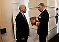 US Navy 090506-N-8273J-039 Chief of Naval Operations (CNO) Adm. Gary Roughead speaks with U.S. Rep. Joe Courtney after meeting with the House Appropriations Committee concerning Military Construction at the U.S. Capitol.jpg