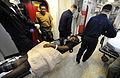 US Navy 100120-N-5345W-050 Stretcher bearers aboard USS Bataan (LHD 5) transfer an injured Haitian woman from main triage to the intensive care unit.jpg
